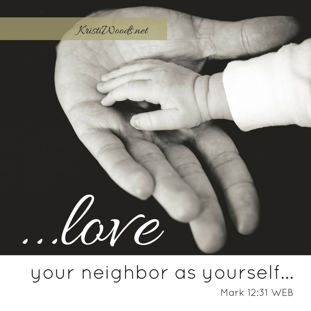 """A baby's hand on an outreached adult hand, Mark 12:31 (WEB) written underneath. """"...love your neighbor as yourself..."""""""