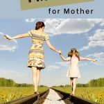 Mother and daughter walking on railroad track, holding hands. Blog post title overhead. Prayer for My Mother