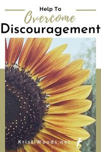 Sunflower with Christian blog post title: Help to Overcome Discouragement